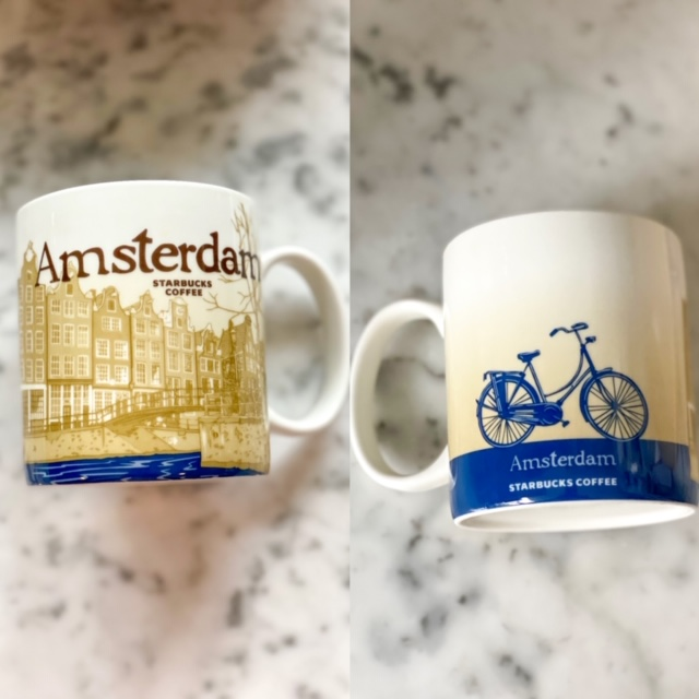 The Starbucks Amsterdam city mug, with images of canals, row houses with gabled roofs, and on the backside, an omafiets is quintessentially Amsterdam.