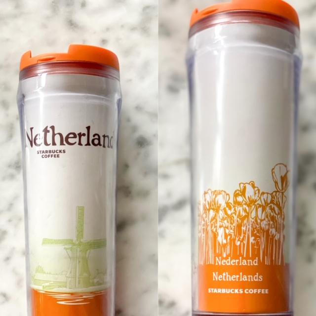 The Netherlands travel mug has shades of orange, as the Dutch royal family hails from the House of Orange-Nassau, with scenes of the typically Dutch windmill on the front and tulip on the back.