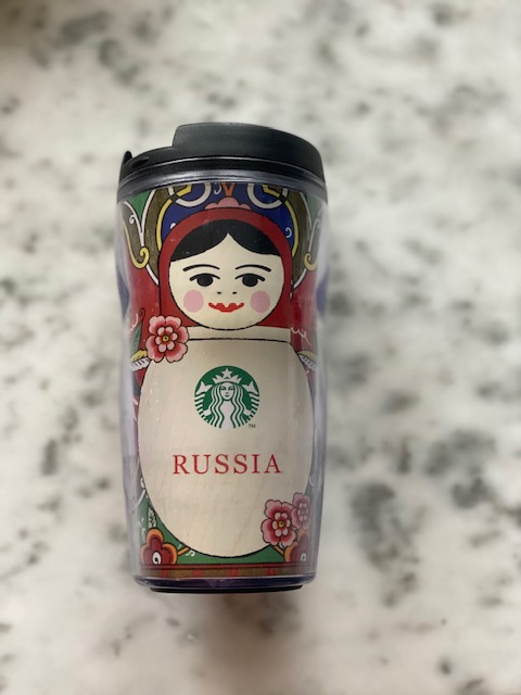 Starbucks travel mug from Russia has an image of a babushka.