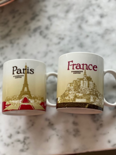 Starbucks France and Paris city mugs.