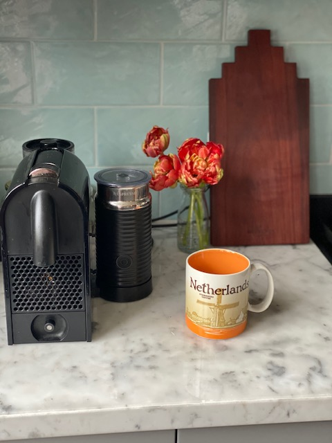 The Netherlands mug has shades of orange, as the Dutch royal family hails from the House of Orange-Nassau, with scenes of the typically Dutch windmill on the front and tulip on the back.