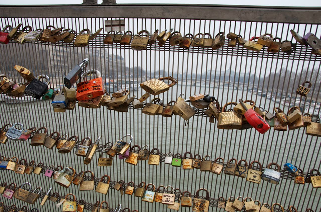 Love locks on the Ponte Passerelle Solfino in Paris France