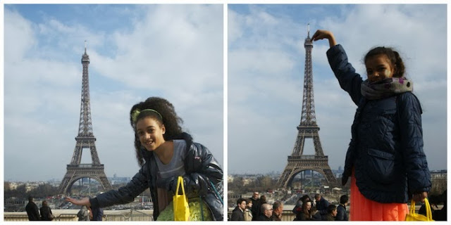 Silly poses next to the Eiffel Tower are a must when traveling with kids.