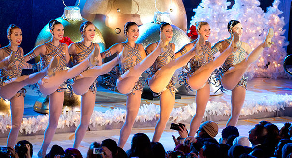 The Radio City Rockettes perform at the Rockefeller Center Christmas tree lighting ceremony in New York. (Photo by Charles Sykes/Invision/AP)