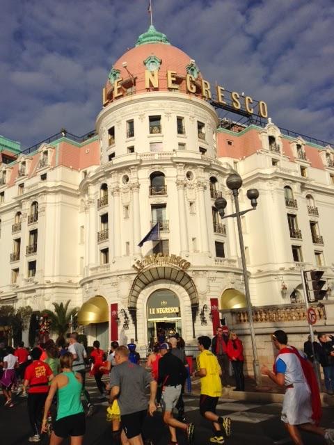 Runners pass the iconic Hotel Negresco in Nice.