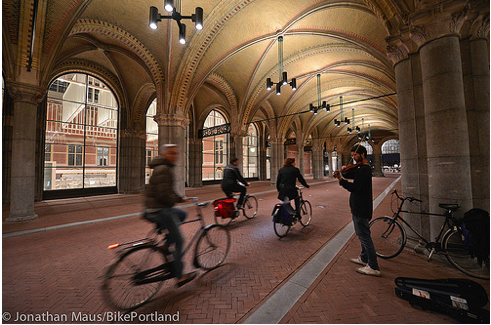 Glass walls of the Rijksmuseum bike tunnel give riders a view into the musuem