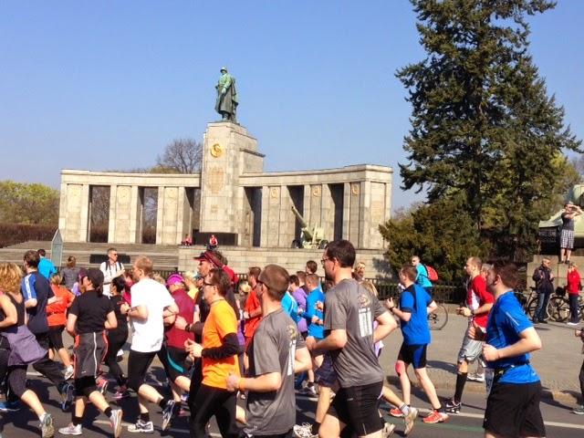 Runners speeding past the Soviet War Memorial in Berlin