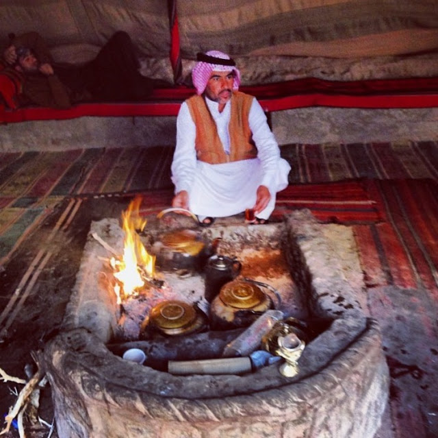 Taking a break to enjoy the Bedouin's traditional spiced tea.