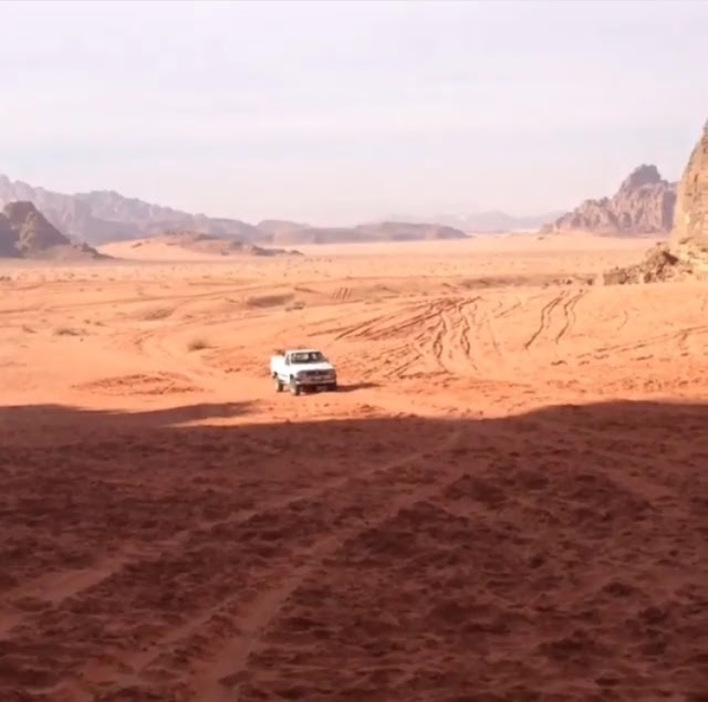 Whizzing through Wadi Rum in a 4x4.