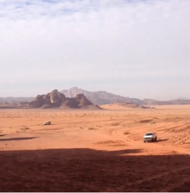 Whizzing through the Wadi Rum in a 4x4.