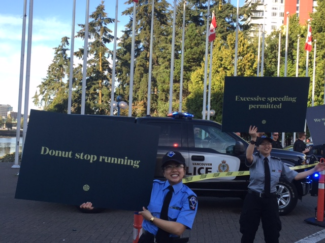 Vancouver police cheer on runners.