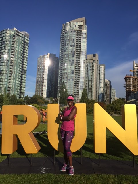 Pausing and posing with props during the Seawheeze half marathon