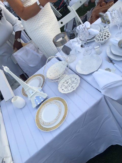 Elegant, all-white table settings are a must at Dîner en Blanc.