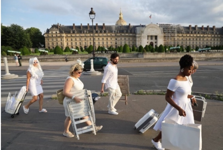 DEB guests carry tables and chairs to secret location.