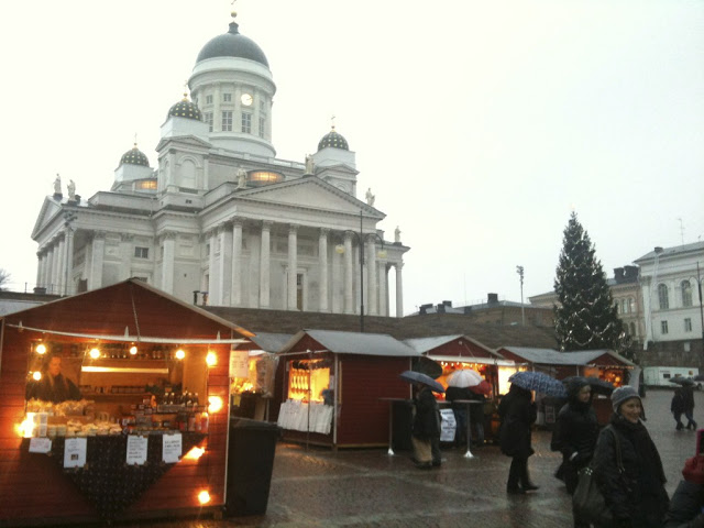 The Lutheran Church in Helsinki looms over Senate Square and the St. Thomas Christmas market. With close to 150 vendors in wooden stalls selling crafts, baked goods and other Christmas specialties, it is the biggest Christmas market in Finland. Helsinki Photo credit: Monique White