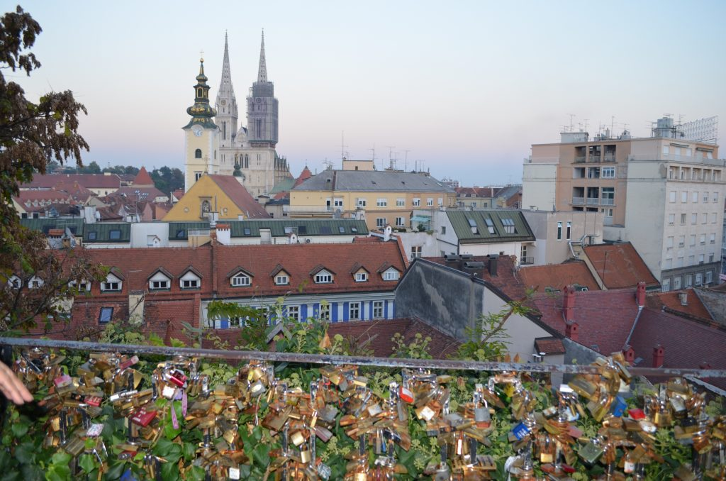Love locks and a view of the church spires of Kaptol from Gornji grad (upper town) in Zagreb. www.anunstoppablejourney.com