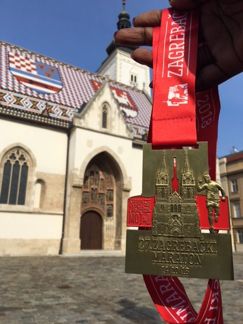 The finisher's medal from the Zagreb Marathon. www.anunstoppablejourney.com