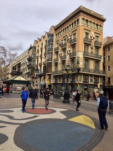 Pedestrians ramble along Barcelona's main street, La Rambla.