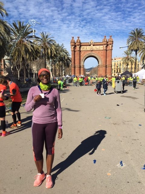 Celebrating a triumphant finish to Mitja Marato de Barcelona at the Arc de Triomf.