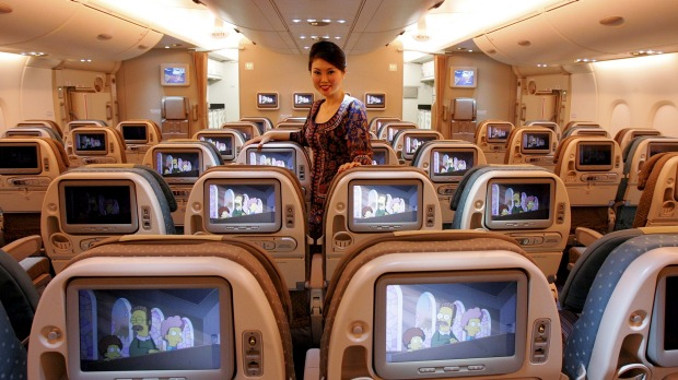 Singapore Airlines flight attendant in iconic sarong kebaya uniform. Photo credit: traveller.com.au