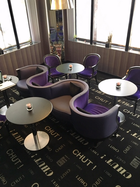 Hotel Design Secret de Paris with its purple décor, back-to-back seating perfect for whispering secrets in someone's ear and dim lighting sets for a clandestine meeting or secret rendezvous. Photo credit: Monique White