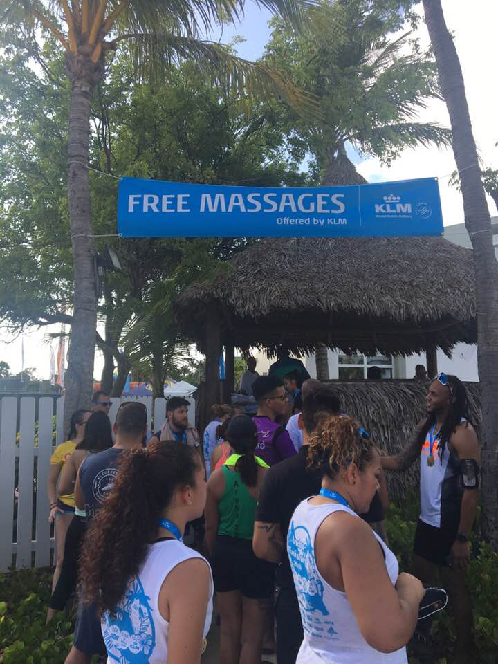 Runners line up for free massages after the KLM Aruba Marathon. Photo credit: Monique White