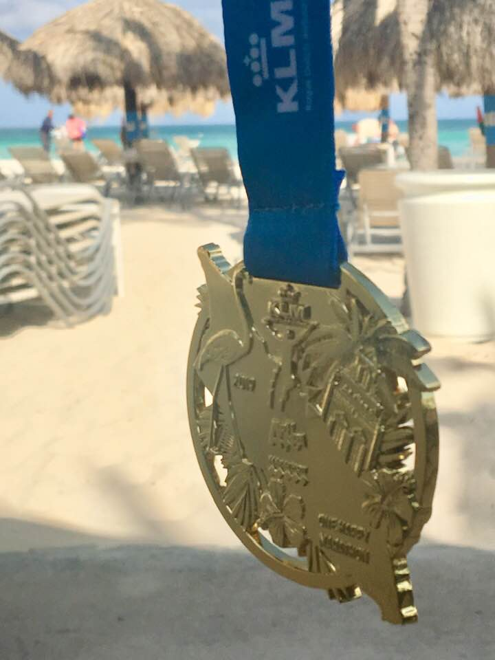 Finisher's medal from Aruba Marathon, which is part of the KLM sponsored Run in the Sun series. Photo Credit: Monique White