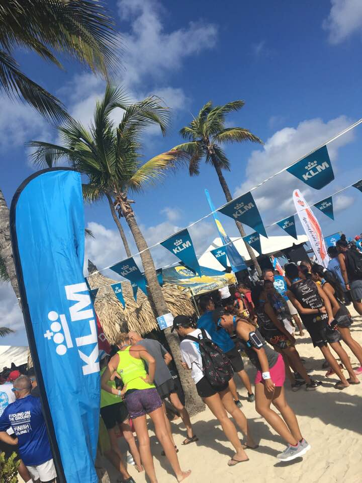 After crossing the finish line of KLM Aruba Marathon, runners ran onto the beach for the party. Photo credit: Monique White