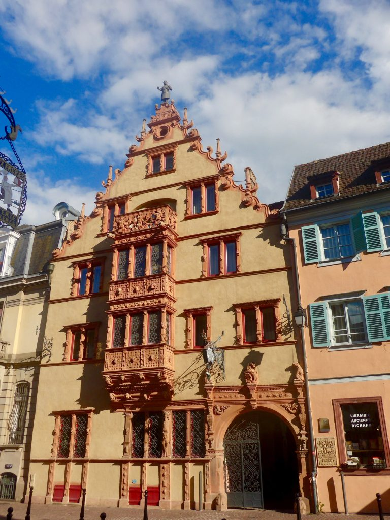 Colmar's House of Heads, the 17th century building adorned with 111 sculptures of heads. Photo credit: Monique White
