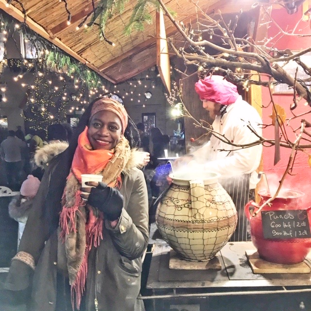Stay warm while shopping the Budapest Christmas markets with a mug of mulled wine made with Hungary's brandy and national drink, Pálinka, and combined with fruit juice, honey, lemon, and spices. Photo credit: Monique White