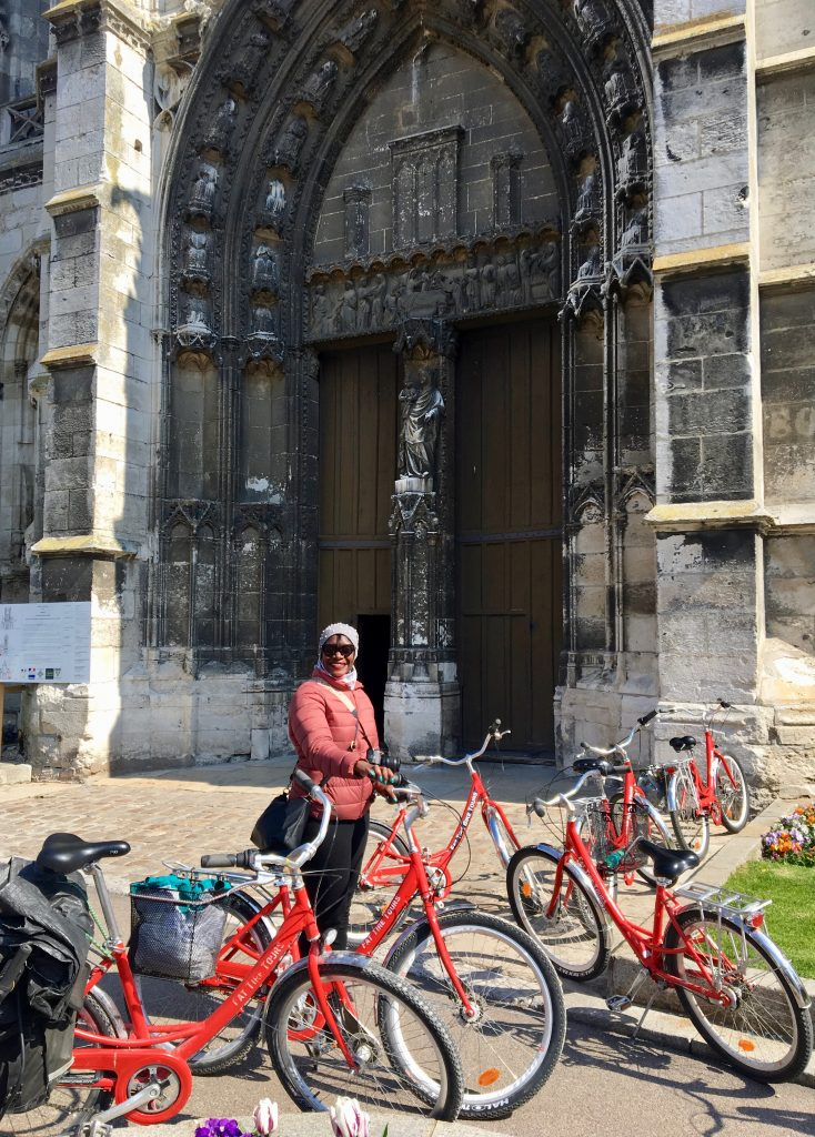 Fat Tire Bike tours passes by the medieval Vernon Cathedral en route to Giverny. Photo credit: Monique White