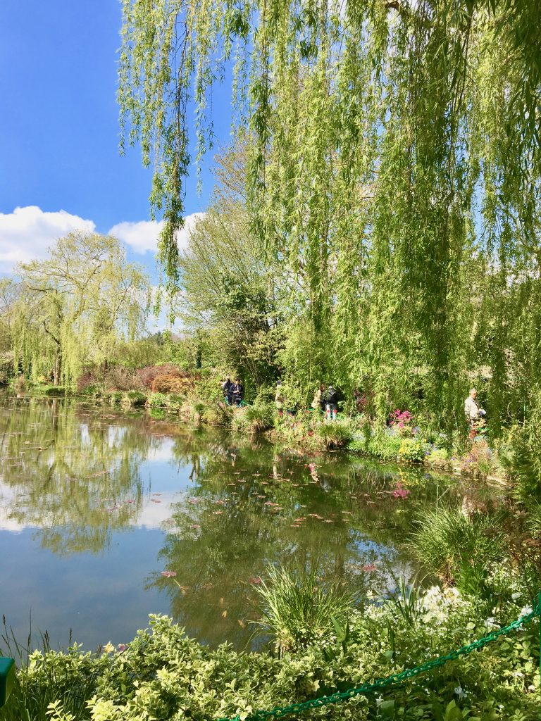 Claude Monet's magnificent gardens, full of pink blossoms, azaleas, irises, weeping willows and famous Japanese bridge, were as dreamy as Monet's paintings and remain just as the artist designed them. Photo credit: Monique White