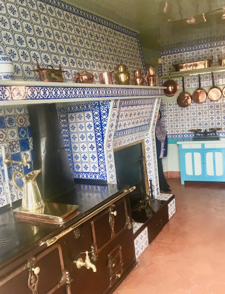 The large kitchen, with its blue and white tiled walls and copper pots and pans, was almost as popular as the gardens. Photo credit: Monique White