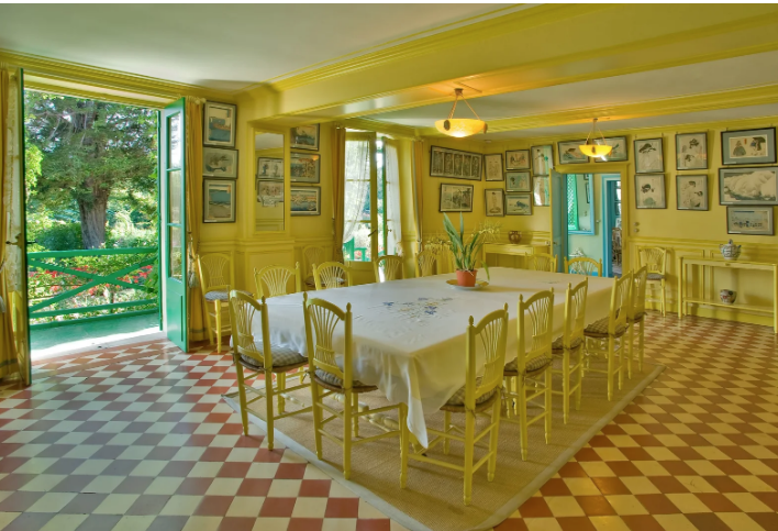 The bright yellow dining room is one of the many colorful rooms found inside Monet's house. Photo credit: Architectural Digest