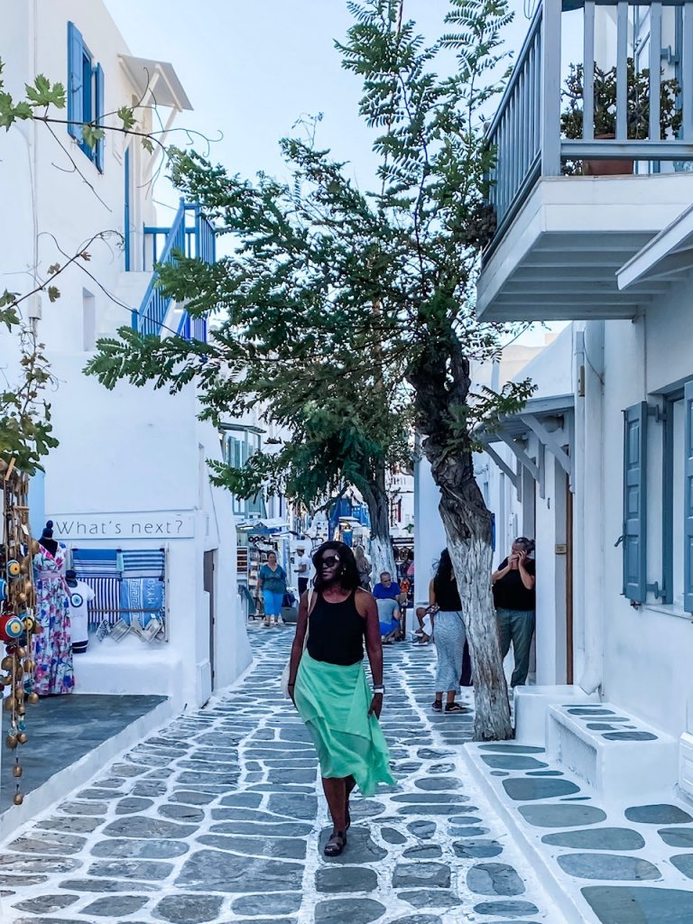 Travel blogger, Monique White, strolling around Mykonos, which had about 25% of the tourists it normally has during the peak summer months. Where to travel during covid-19 | Coronavirus travel advice | coronavirus travel restrictions | Coronavirus travel tips | Travel during Coronavirus | Europe travel planning | travel | travel tips