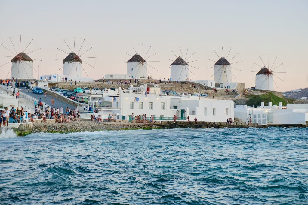 The Kato Mylo windmills are one of the most iconic landmarks on Mykonos. Mykonos itinerary | Greece Travel Guide | Mykonos Travel Guide | Greece Itinerary | Things to do in Greece | Mykonos Travel Tips | Greece Travel Tips | Greek Island Travel Tips Things to do in Mykonos| Things to do in Mykonos at night | Best Beaches in Mykonos | Best nightlife in Myconos | historical things to do in mykonos | Greek islands | Greek wine | Europe travel planning | travel | travel tips