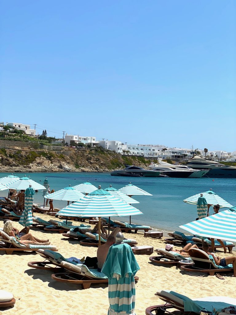 Psarou is one of the most upscale beaches on Mykonos and home to the wonderful beach club, Nammos. Mykonos itinerary | Greece Travel Guide | Mykonos Travel Guide | Greece Itinerary | Things to do in Greece | Mykonos Travel Tips | Greece Travel Tips | Greek Island Travel Tips Things to do in Mykonos| Things to do in Mykonos at night | Best Beaches in Mykonos | Best nightlife in Myconos | historical things to do in mykonos | Greek islands | Greek wine | Europe travel planning | travel | travel tips