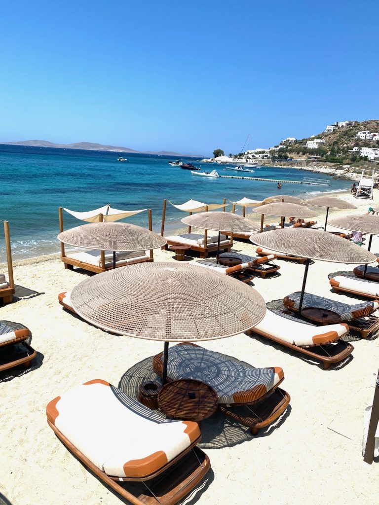 Beach loungers at Agios Ioannis, which is considered one of the most beautiful beaches on Mykonos. Mykonos itinerary | Greece Travel Guide | Mykonos Travel Guide | Greece Itinerary | Things to do in Greece | Mykonos Travel Tips | Greece Travel Tips | Greek Island Travel Tips Things to do in Mykonos| Things to do in Mykonos at night | Best Beaches in Mykonos | Best nightlife in Myconos | historical things to do in mykonos | Greek islands | Greek wine | Europe travel planning | travel | travel tips