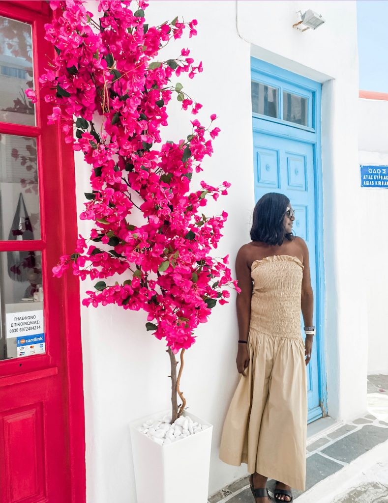 Wandering through Mykonos Town, with its maze of narrow, cobbled, Instagrammable streets with the whitewashed cube buildings accented with azure doors and shutters, and sprinkled with bougainvillea, is a must. Mykonos itinerary | Greece Travel Guide | Mykonos Travel Guide | Greece Itinerary | Things to do in Greece | Mykonos Travel Tips | Greece Travel Tips | Greek Island Travel Tips Things to do in Mykonos| Things to do in Mykonos at night | Best Beaches in Mykonos | Best nightlife in Myconos | historical things to do in mykonos | Greek islands | Greek wine | Europe travel planning | travel | travel tips
