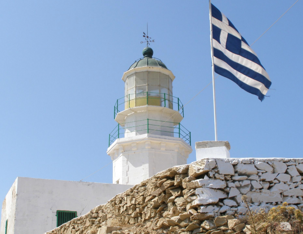 Armenistis Lighthouse stands as a reminder of Mykonos' maritime history, and offers unforgettable sunset views. Mykonos itinerary | Greece Travel Guide | Mykonos Travel Guide | Greece Itinerary | Things to do in Greece | Mykonos Travel Tips | Greece Travel Tips | Greek Island Travel Tips Things to do in Mykonos| Things to do in Mykonos at night | Best Beaches in Mykonos | Best nightlife in Myconos | historical things to do in mykonos | Greek islands | Greek wine | Europe travel planning | travel | travel tips